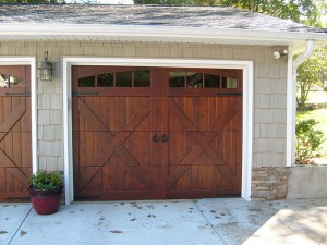 CHI's 5434A Model door with arched stockton windows. Wood overlay with Barcelona Handles & Hinges.